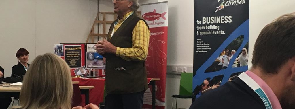 A man talking at a networking event
