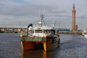 Grimsby Dock Tower with a Windcat Workboat